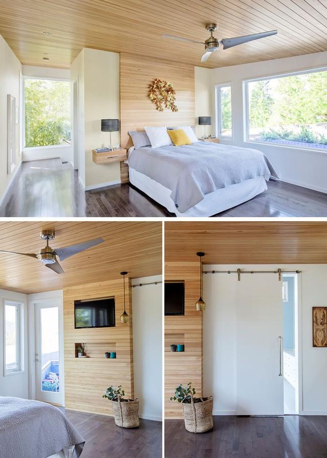 Loại gỗ ốp sáng màu được sử dụng đồng thời để trang trí nhiều góc trong phòng ngủ như mảng tường ở đầu giường, phía đối diện giường, tủ để đèn ngủ.