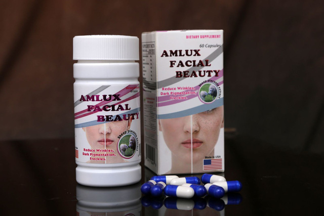 Chỉ là thực phẩm bảo vệ sức khỏe nhưng viên nang Amlux Facial Beaty đang được quảng cáo như thuốc chữa bệnh. Ảnh: TL