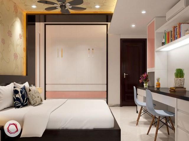 3. Kiểu tủ âm tường bao giờ cũng có tác dụng làm không gian sống trông gọn gàng hơn. Căn phòng này không ngoại lệ. Hệ tủ cao sát trần lại âm tường đã giúp căn phòng trông gọn gàng và rất thẩm mỹ.
