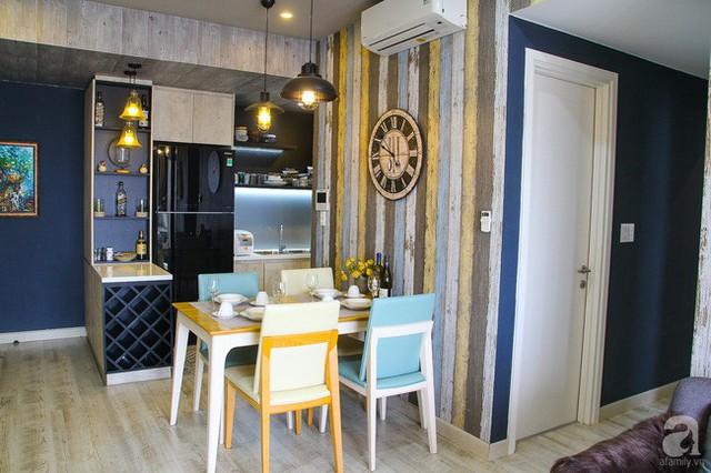 Góc bàn ăn được chọn gam màu vàng và xanh làm màu nhấn, tăng thêm không khí vui vẻ, ấm cúng cho mọi người khi ngồi ăn uống.