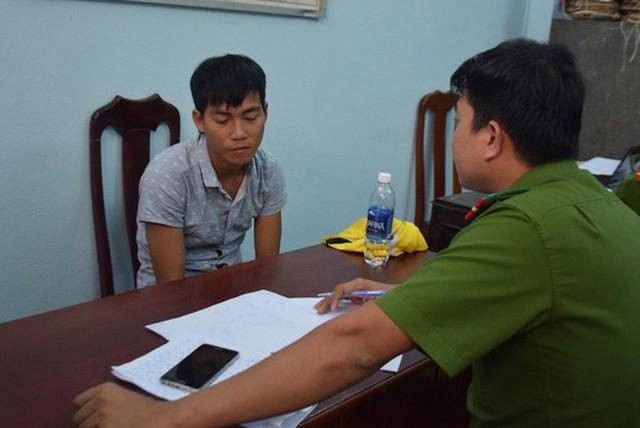 Nghi phạm Trần Văn Quang tại cơ quan công an - Ảnh: Ngọc Thắng