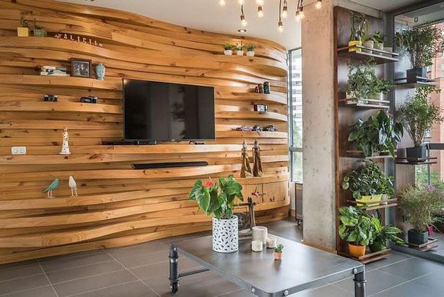 Nếu là người đam mê chất liệu gỗ trong trang trí nhà cửa, hãy sử dụng tường gỗ trong phòng khách để trải nghiệm những cảm nhận thực sự khác biệt với những ý tưởng thiết kế sau: