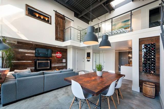 Gỗ được sử dụng làm nổi bật không gian phòng khách.