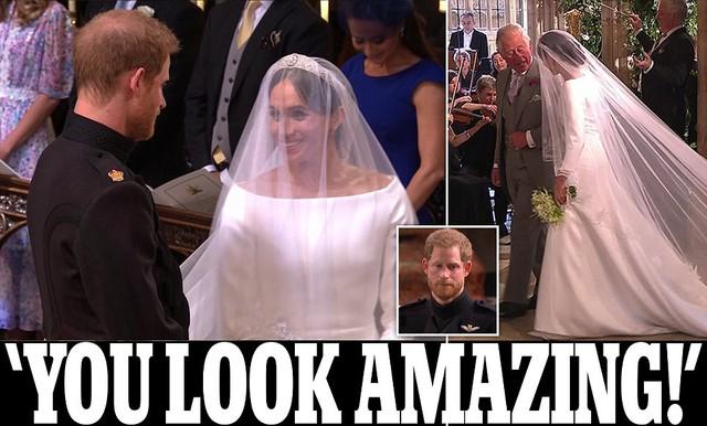 Meghan được cha chồng dắt tay vào lễ đường. Cô và hoàng tử Harry tình tứ nắm tay nhau.