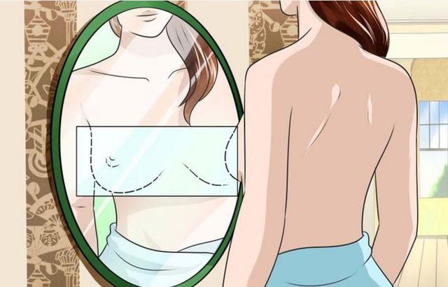 Tự kiểm tra vú thông qua gương. (Ảnh minh họa)