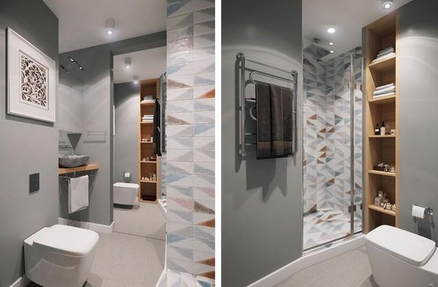 Khu vệ sinh rộng có khoang tắm đứng riêng, kệ tủ để đồ thoải mái.