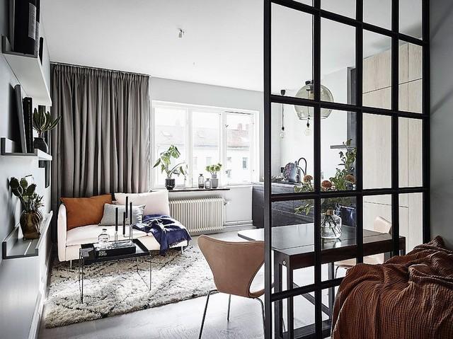 Phòng khách theo phong cách Scandinavia với ghế dài nhỏ, màu trắng.