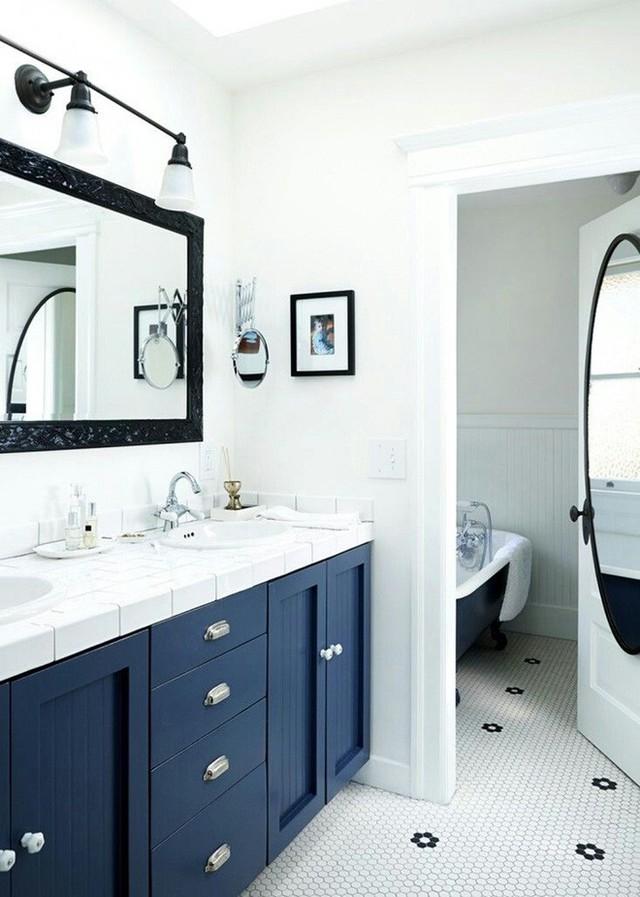 Với những căn phòng tắm có gam màu chủ đạo là trắng, việc lựa chọn màu sơn tủ có vẻ như khá dễ dàng.