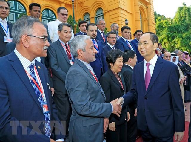Chủ tịch nước Trần Đại Quang với các đại biểu. (Ảnh: Nhan Sáng/TTXVN)