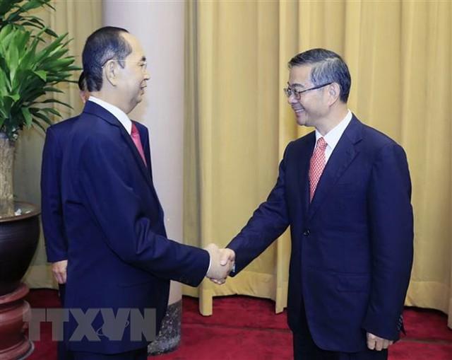 Chủ tịch nước Trần Đại Quang tiếp Chánh án Tòa án Nhân dân Tối cao Trung Quốc Chu Cường. (Ảnh: Nhan Sáng/TTXVN)