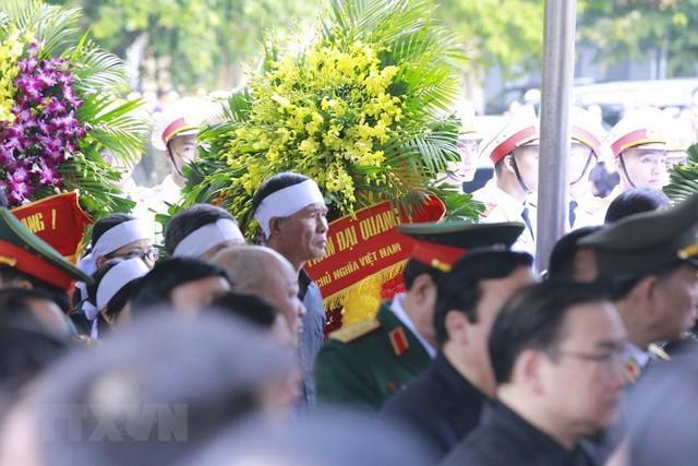 Người thân Chủ tịch nước Trần Đại Quang tại lễ Quốc tang. (Ảnh: Trọng Đạt/TTXVN)