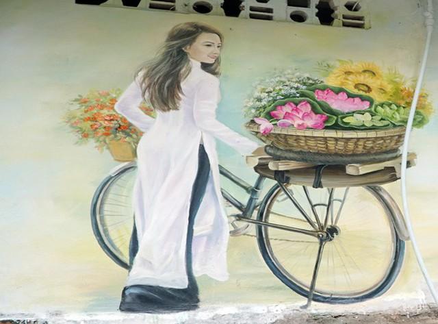 Bức tranh về người con gái Hà thành dịu dàng, mang đến cho người xem cảm giác bình yên, trong trẻo.