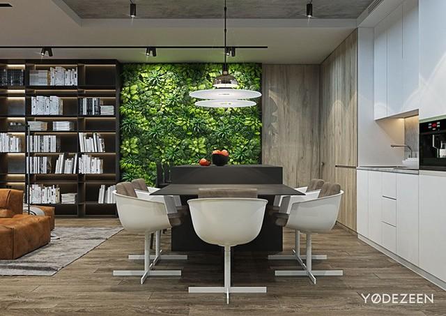 Một bức tường bằng cây xanh bao phủ toàn bộ không gian phòng ăn giúp không gian trở nên tươi mát.