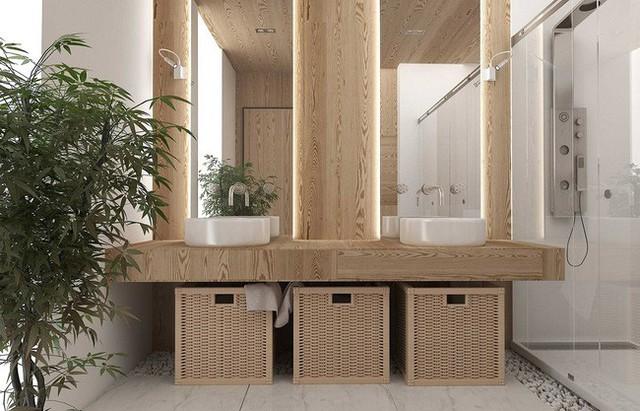 Phòng tắm cũng tích hợp các cây xanh có tính thẩm mĩ. Các viên sỏi trắng rải dưới sàn cho một vẻ đẹp hoàn hảo.