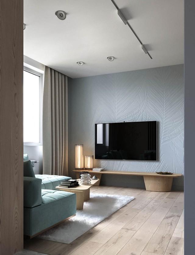 Đối diện với sofa xanh chính là bức tường đá khổng lồ với họa tiết lá được chạm khắc tinh tế.