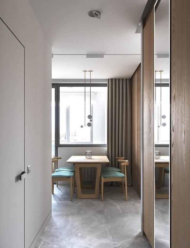 Màu xanh nước biển và tông màu gỗ được thống nhất từ phòng khách vào đến đây.