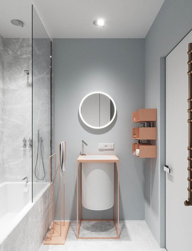 Phòng tắm là một thiết kế tối giản với chất liệu đồng làm chủ đạo. Vì có diện tích khá nhỏ nên mẫu nội thất này giúp không gian trông tinh tế và nhẹ nhàng hơn.