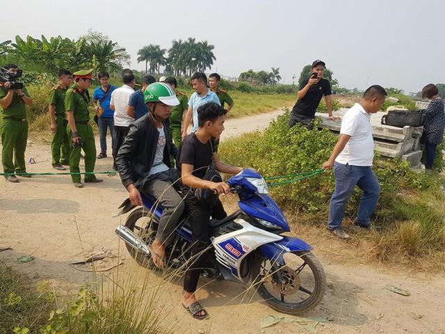 Thực nghiệm hiện trường vụ nam sinh chạy Grab bị sát hại ở Hà Nội - Ảnh 10.