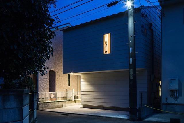 Ngôi nhà có kiến trúc độc đáo gắn liền với thiên nhiên dù vị trí nằm ngay trong phố lớn - Ảnh 5.