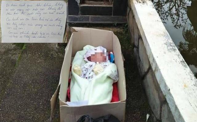 Bé trai 2 tháng bị bỏ rơi trong thùng giấy cùng 'tâm thư' - Ảnh 1.