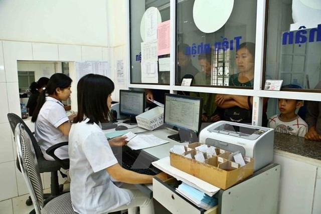 Đẩy mạnh ứng dụng CNTT trong KCB: Người dân không còn ngại khám bệnh bằng thẻ BHYT - Ảnh 1.