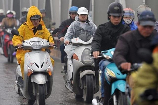 Không khí lạnh tràn xuống, người dân miền Bắc đi làm trong mưa rét - Ảnh 2.