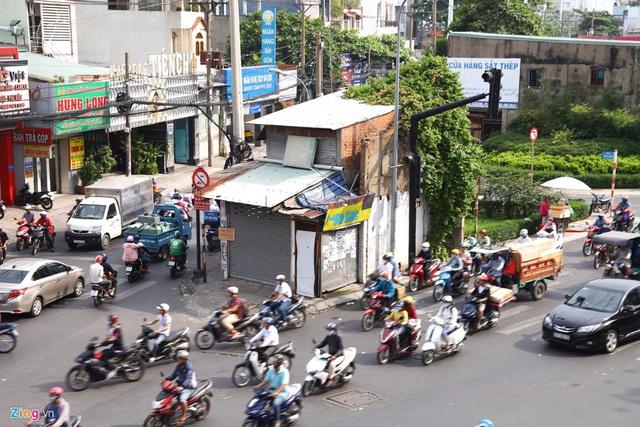 Cận cảnh căn nhà giữa giao lộ ở TP.HCM được đền bù 5,1 tỷ  - Ảnh 2.