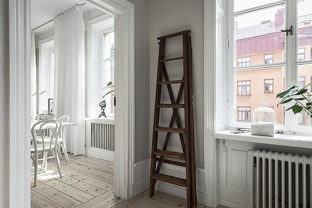 Căn hộ rộng 62m² sử dụng màu trắng là chủ yếu nhưng chẳng hề nhàm chán nhờ cách trang trí có tính thẩm mỹ cao - Ảnh 11.