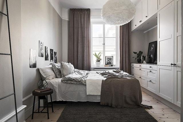 Căn hộ rộng 62m² sử dụng màu trắng là chủ yếu nhưng chẳng hề nhàm chán nhờ cách trang trí có tính thẩm mỹ cao - Ảnh 12.