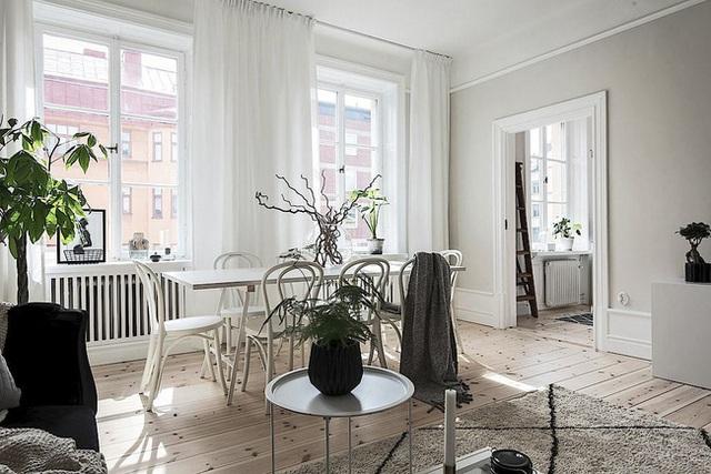 Căn hộ rộng 62m² sử dụng màu trắng là chủ yếu nhưng chẳng hề nhàm chán nhờ cách trang trí có tính thẩm mỹ cao - Ảnh 4.