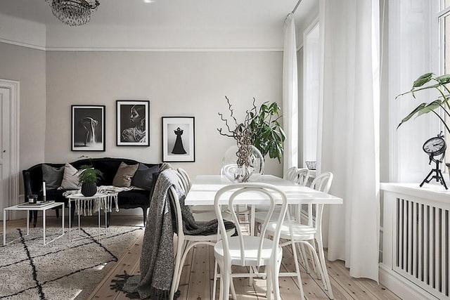 Căn hộ rộng 62m² sử dụng màu trắng là chủ yếu nhưng chẳng hề nhàm chán nhờ cách trang trí có tính thẩm mỹ cao - Ảnh 5.
