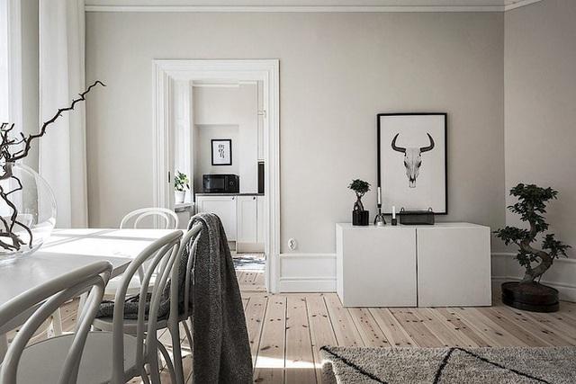 Căn hộ rộng 62m² sử dụng màu trắng là chủ yếu nhưng chẳng hề nhàm chán nhờ cách trang trí có tính thẩm mỹ cao - Ảnh 8.