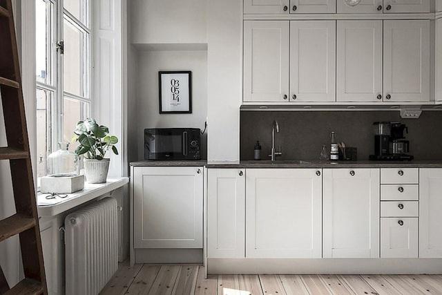 Căn hộ rộng 62m² sử dụng màu trắng là chủ yếu nhưng chẳng hề nhàm chán nhờ cách trang trí có tính thẩm mỹ cao - Ảnh 9.