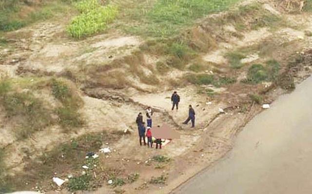 Xác định danh tính thi thể 2 bố con trên sông Hồng, đoạn qua cầu Ngọc Tháp - Ảnh 1.