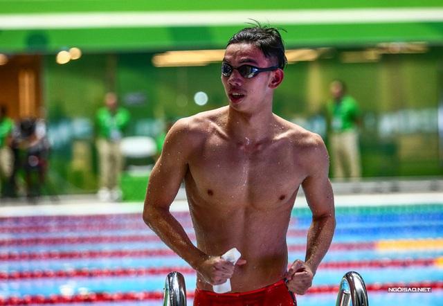 Huy Hoàng khoe cơ bắp sau khi phá kỷ lục SEA Games - Ảnh 7.