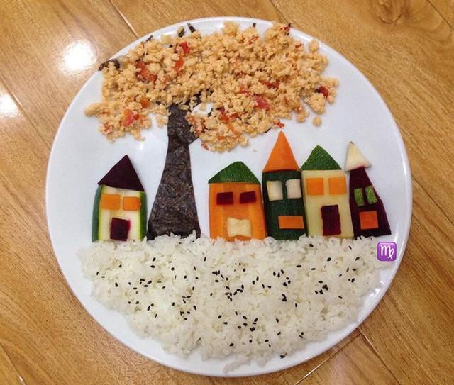 Những ngôi nhà lúp xúp bên dưới cây cổ thụ được làm từ trứng bác cà chua và rong biển, những ngôi nhà đầy màu sắc làm từ các loại rau củ và đất là cơm rắc vừng đen.