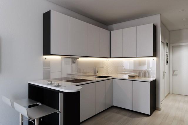 Một căn bếp nhỏ gọn được thiết kế hình chữ L một cách hợp lý và tiết kiệm diện tích. Bếp màu trắng - đen cổ điển với hệ thống đèn ẩn bên dưới kệ tủ cho ánh sáng ấm áp nơi khu vực nấu nướng, đồng thời khiến bếp trở nên sáng bóng hơn. Một quầy bar nhỏ được thiết kế ngay góc trái với bộ ghế kim loại sang trọng để chủ nhân có thể thưởng thức bữa ăn ngay tại nơi này.