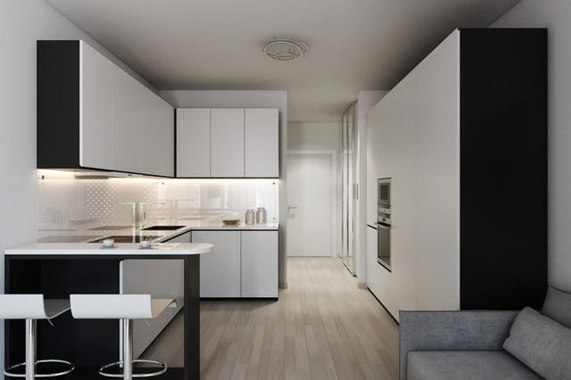 Nhìn từ góc này, bạn sẽ thấy đối diện căn bếp là nơi dành cho không gian lưu trữ. Nó vừa là bức tường đồng thời cũng là chiếc tủ rộng rãi để đặt các thiết bị gia dụng hay làm quần áo, giày dép một cách gọn gàng, khoa học mà không hề gây choáng diện tích.