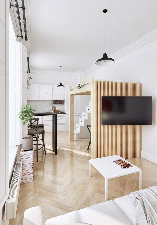 Gam màu chủ đạo của căn hộ là trắng và màu gỗ tự nhiên tươi sáng. Gỗ để lát sàn, đóng khung phòng làm việc và là bức tường sọc phân chia nó với phòng khách. Bức tường gỗ này được tận dụng để treo chiếc ti vi đối diện sofa. Cặp đèn thả thiết kế cổ điển cũng được lựa chọn để tăng thêm tính thẩm mỹ cho không gian nhà ở.