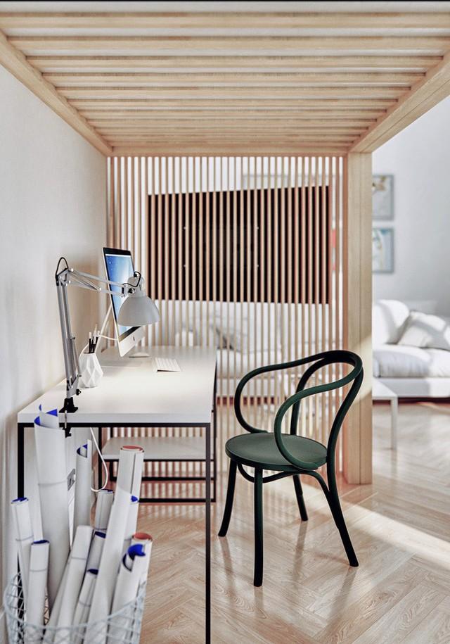 Phòng làm việc tại gia của anh chàng công sở trông gọn gàng, ngăn nắp hơn chúng ta hình dung đúng không nào? Một chiếc bàn với phần chân kim loại thanh mảnh, một chiếc máy tính, một mẫu đèn bàn tinh tế, giỏ đựng tài liệu bên cạnh, nổi bật hơn cả là chiếc ghế màu xanh rêu được thiết kế cổ điển đồng thời là điểm nhấn về màu sắc cho khu vực này.