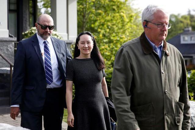 Bà Meng rời khỏi nơi bị quản thúc hôm 8/5. Ảnh: Reuters.