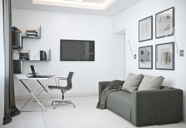 Phòng làm việc bố trí khéo léo, ghế sofa màu xám làm nơi nghỉ ngơi khi chủ nhân muốn yên tĩnh đọc sách.