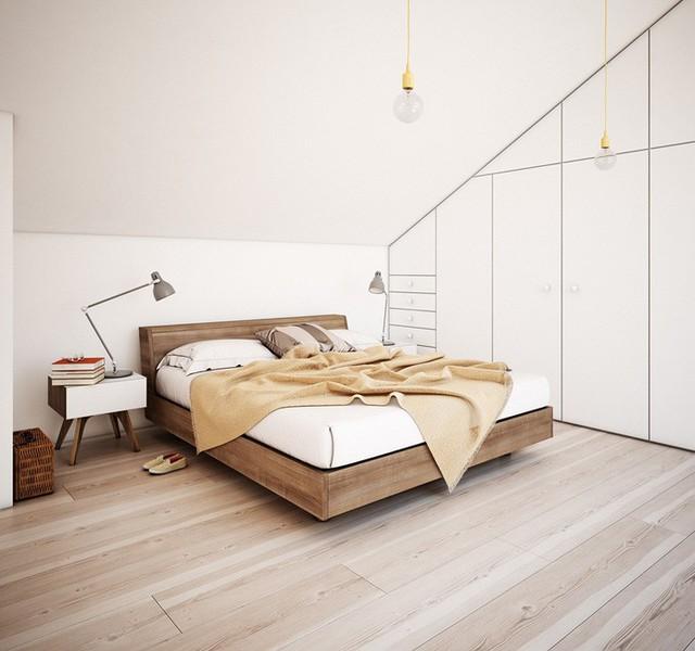 Chiếc giường này tạo ấn tượng ấm áp rất đặc trưng với khung gỗ mượt mà và vải dệt mocha. Những bóng đèn treo màu vàng treo phía trên đều nằm trong bộ sưu tập E27 của nhà thiết kế Mattias Ståhlbom.