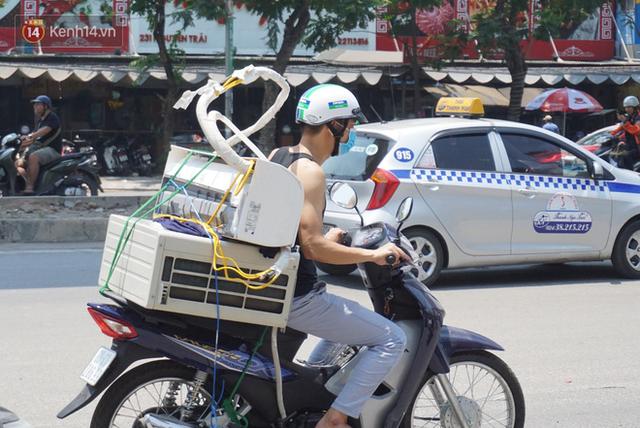 Nắng nóng đỉnh điểm ở Hà Nội, thợ điều hòa kiếm tiền triệu mỗi ngày - Ảnh 5.