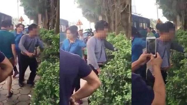 Nhân viên xe buýt và người dân đưa người đàn ông nghi sàm sờ phụ nữ về công an huyện Thanh Oai. Ảnh cắt từ clip