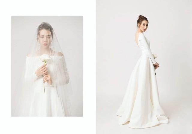 Đàm Thu Trang khoe vẻ đẹp mong manh trong bộ váy cưới lộng lẫy.