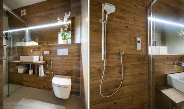 Gạch sứ trên nền của gỗ ván và các yếu tố thiết kế phòng tắm nổi tạo ra một không gian phòng tắm nhỏ mới, hiện đại hơn.