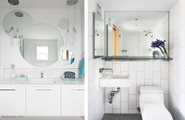 Không gian phòng tắm trông rộng hơn nhờ sử dụng gương lớn cho thay vì các bức tường.