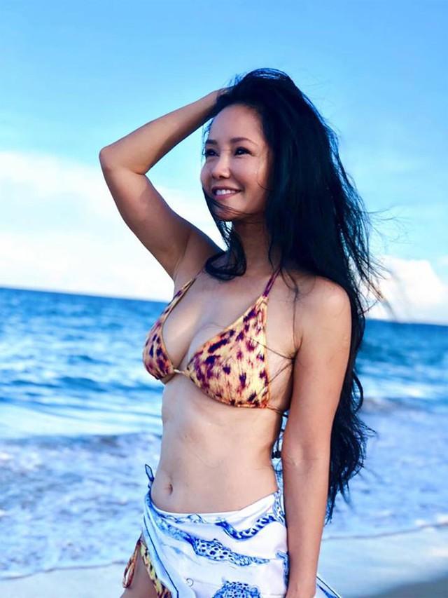 Những lần hiếm hoi Hồng Nhung diện bikini, khoe thân hình bốc lửa trước ống kính.