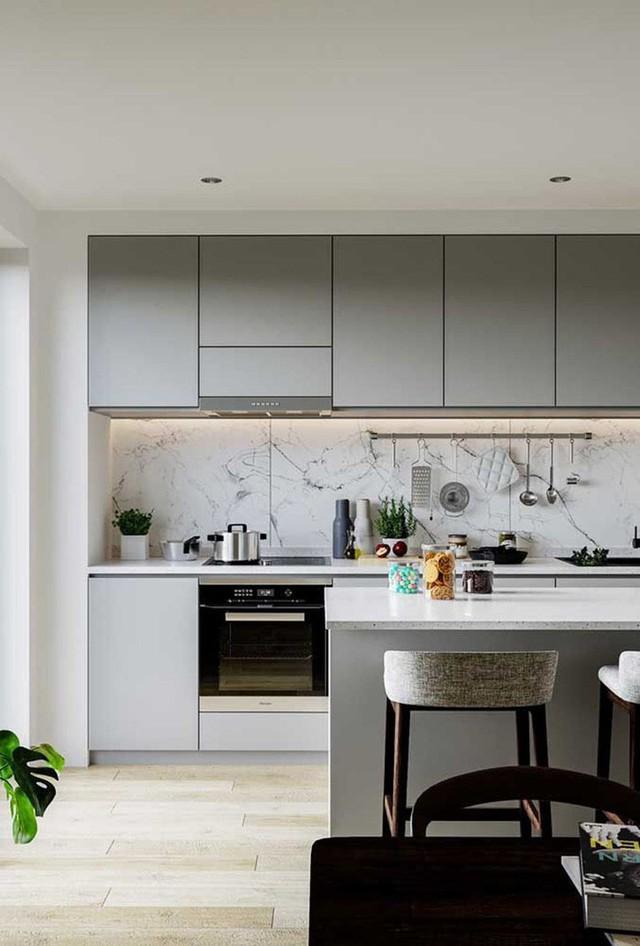 Bên cạnh ánh sáng tự nhiên, bạn có thể ưu tiên lựa chọn các vật liệu phản sáng và tông màu nhẹ cho căn bếp.